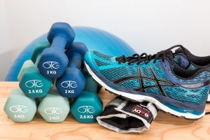 blue sports weights and running shoes