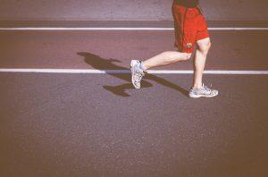 man-running-on-concrete-road-in-sun-gait-analysis