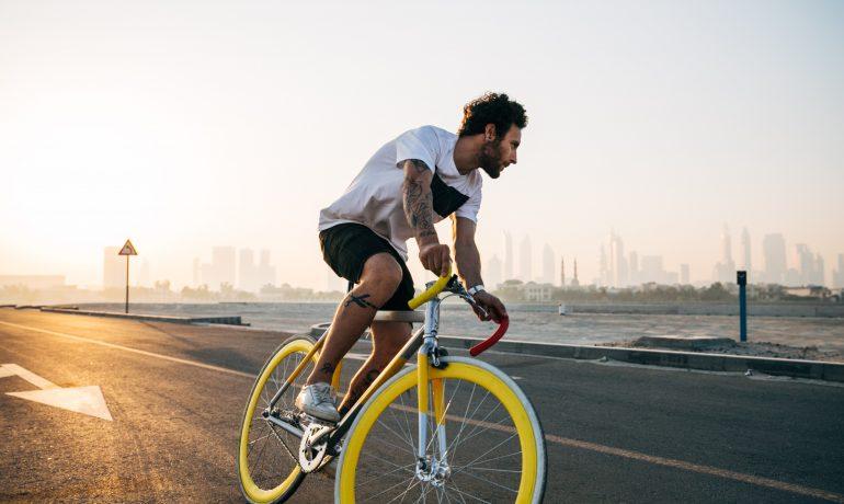 man-riding-bike-on-road-in-daytime